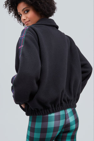 Black, fleece, zip up jacket, with panels of plaid on the side of each sleeve