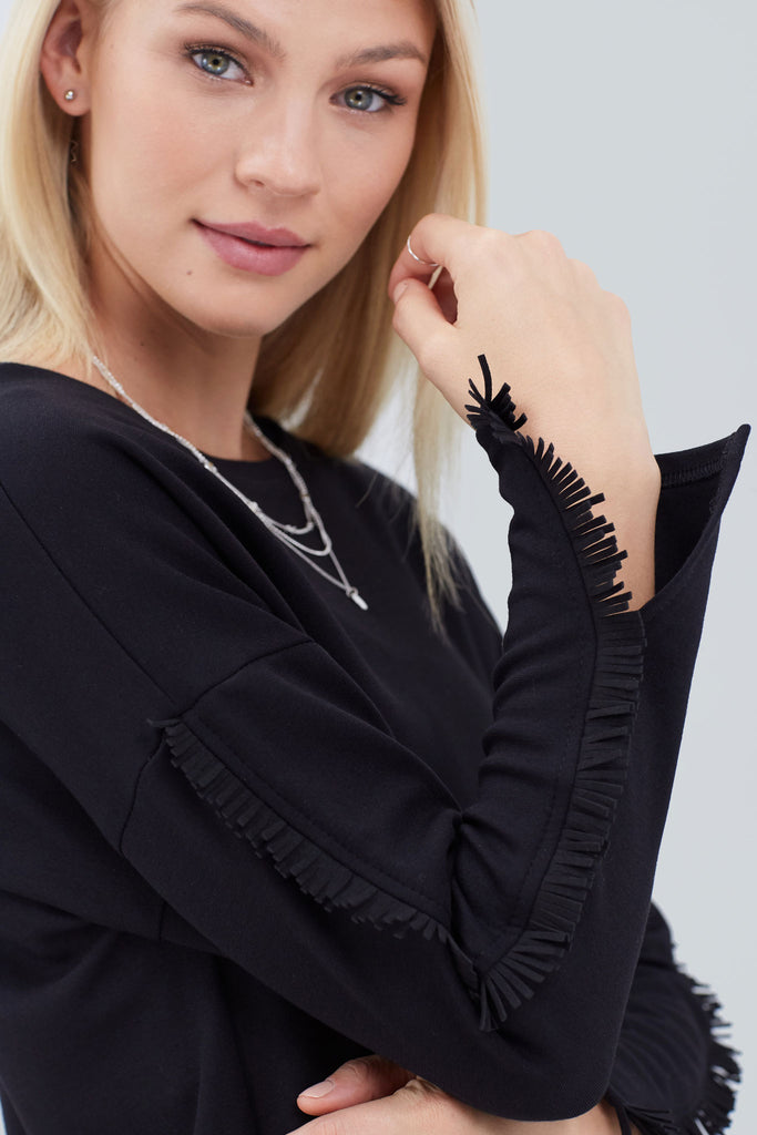 Black crewneck with fringe sleeves, and slits on the end of each arm