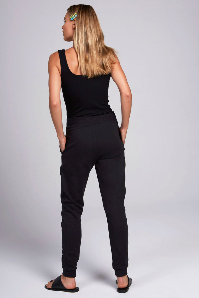 Basic, all black, fleece jogger with piping down the middle of each leg.