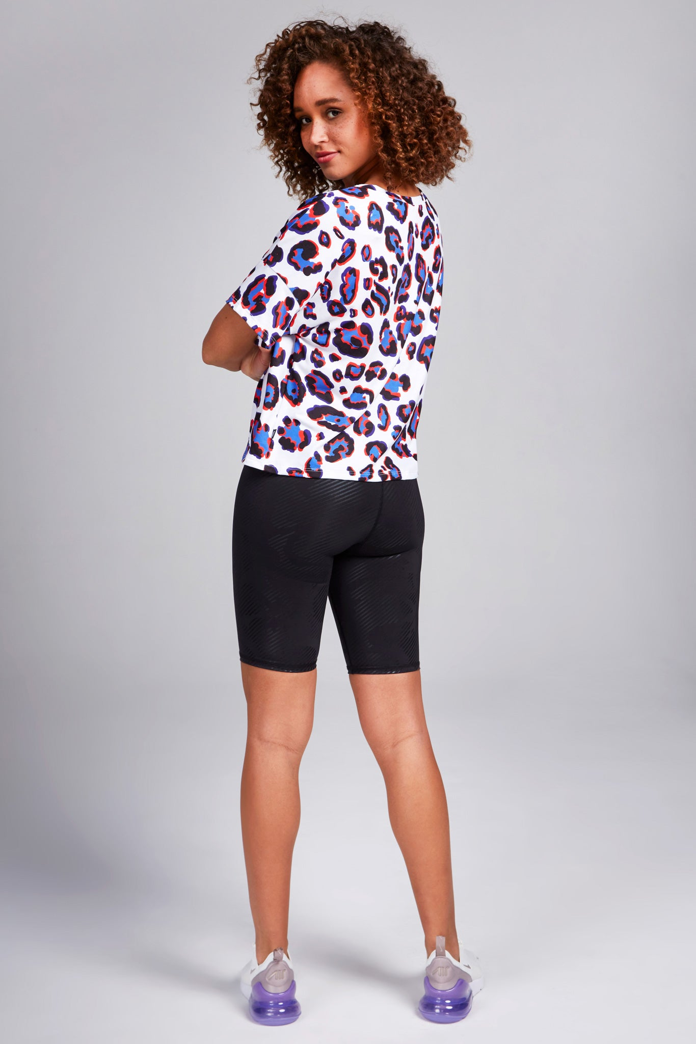 Solid black biker shorts, overlaid with subtle black foil patterns of camo.