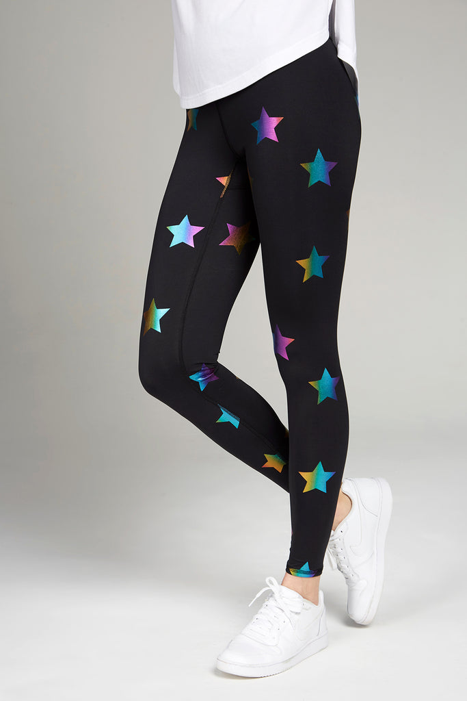Full length, high waisted black leggings with rainbow foil stars
