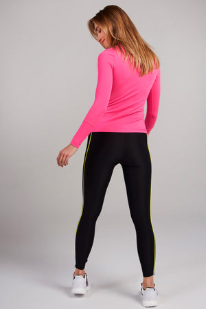 Full length, black legging with two lines of yellow piping down the side of each leg