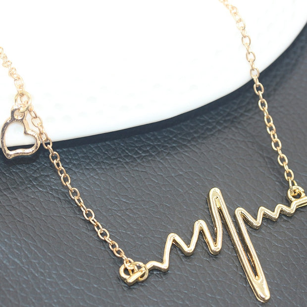 4ebff92de 10 Pieces/lot Heart Pendant Necklaces Women Men Gold Silver Color Lightning ECG  Heartbeat Pendant