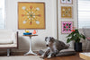 Four photographs framed and hanging in an old hawaiian style home with mid-century modern furniture and a great dane lounging