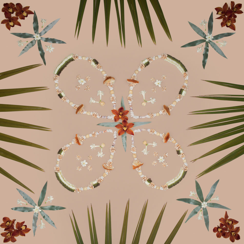 live a lei life leis and fan palm tuberose orchids to create a symmetrical photo