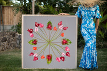 Load image into Gallery viewer, Woman in a Hawaiian mumu holding a large 4ftx4ft print called Spindly Flamingo inspired by the Hawaiian quilt