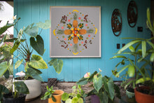 Load image into Gallery viewer, Chinatown Fruit Salad is placed on the wall among the tropical flowers near at a homes entryway.