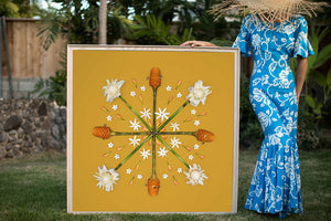 Woman in a hawaiian mumu holding a large 4ftx4ft photographic print with a handmade ash frame
