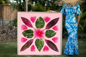Woman in a Hawaiian mumu holding a large 4ftx4ft Mr. Bomaxstic photographic art inspired by the hawaiian quilt
