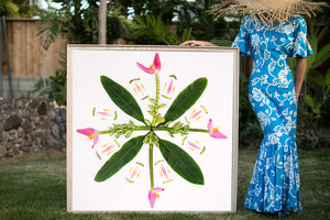 Woman in a hawaiian mumu holding a large 4ftx4ft musa ornata banana plan photographic art inspired by the hawaiian quilt
