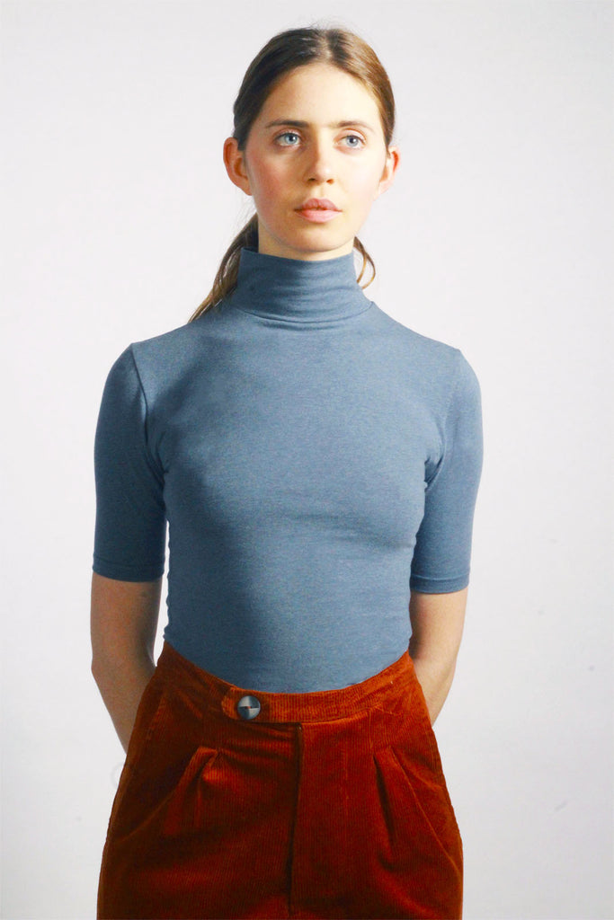 Air Turtleneck. A classic wardrobe staple, this short sleeved turtle neck is cut from organic cotton. The soft & stretchy material elegantly silhouettes your figure and can be easily dressed up or down.