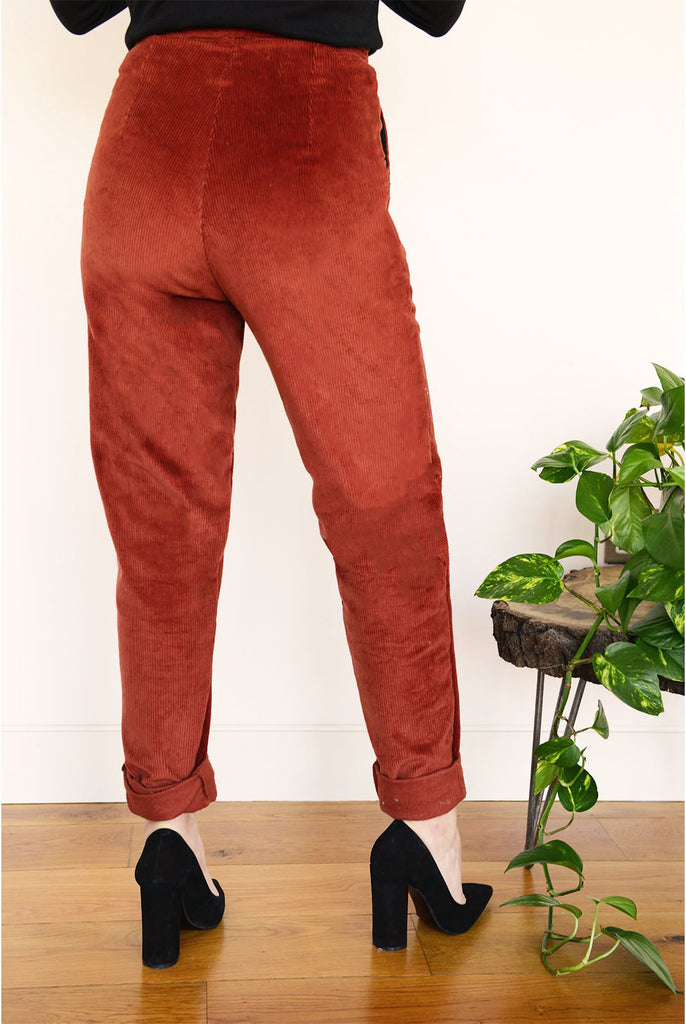 Corduroy Trousers. These cords are a high waist, slim fitting pair of trousers with a gold back zipper. The stretchy material allows you to move freely & is super soft to the touch.
