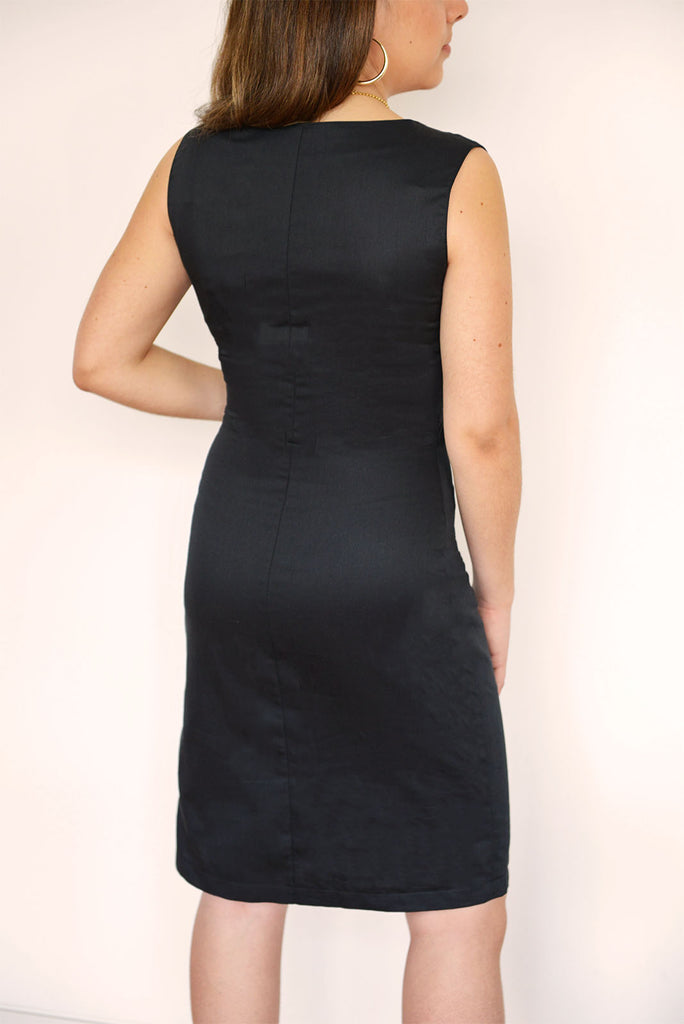 Because you can never go wrong with a little black dress.  This slim fit LBD is structured around the waist and falls to the most flattering part of the leg. It's embellished with ruffle details and a V-neck collar. Perfect for work or any time you want to throw a sophisticated look together.