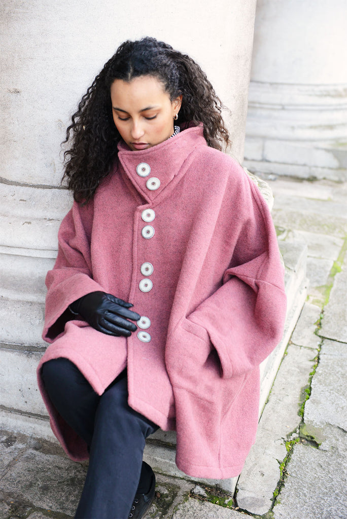 Spring Coat in Rose. Inspired by the high-neck coats from the 1960s, this Spring coat is a chic addition to any wardrobe looking for a splash of colour. It's an ideal top layer to throw over a t-shirt on a sunny day or to throw over layers during the colder seasons.