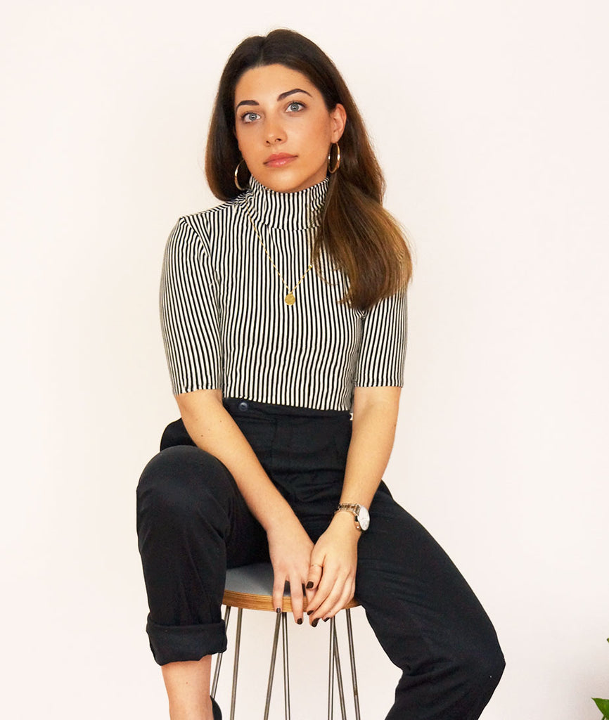 Stripe Turtleneck. A classic wardrobe staple, this short sleeved turtle neck is cut from organic cotton. The soft & stretchy material elegantly silhouettes your figure and can be easily dressed up or down.