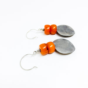 Matte silver-tone discs and deep orange resin bead earrings alt view