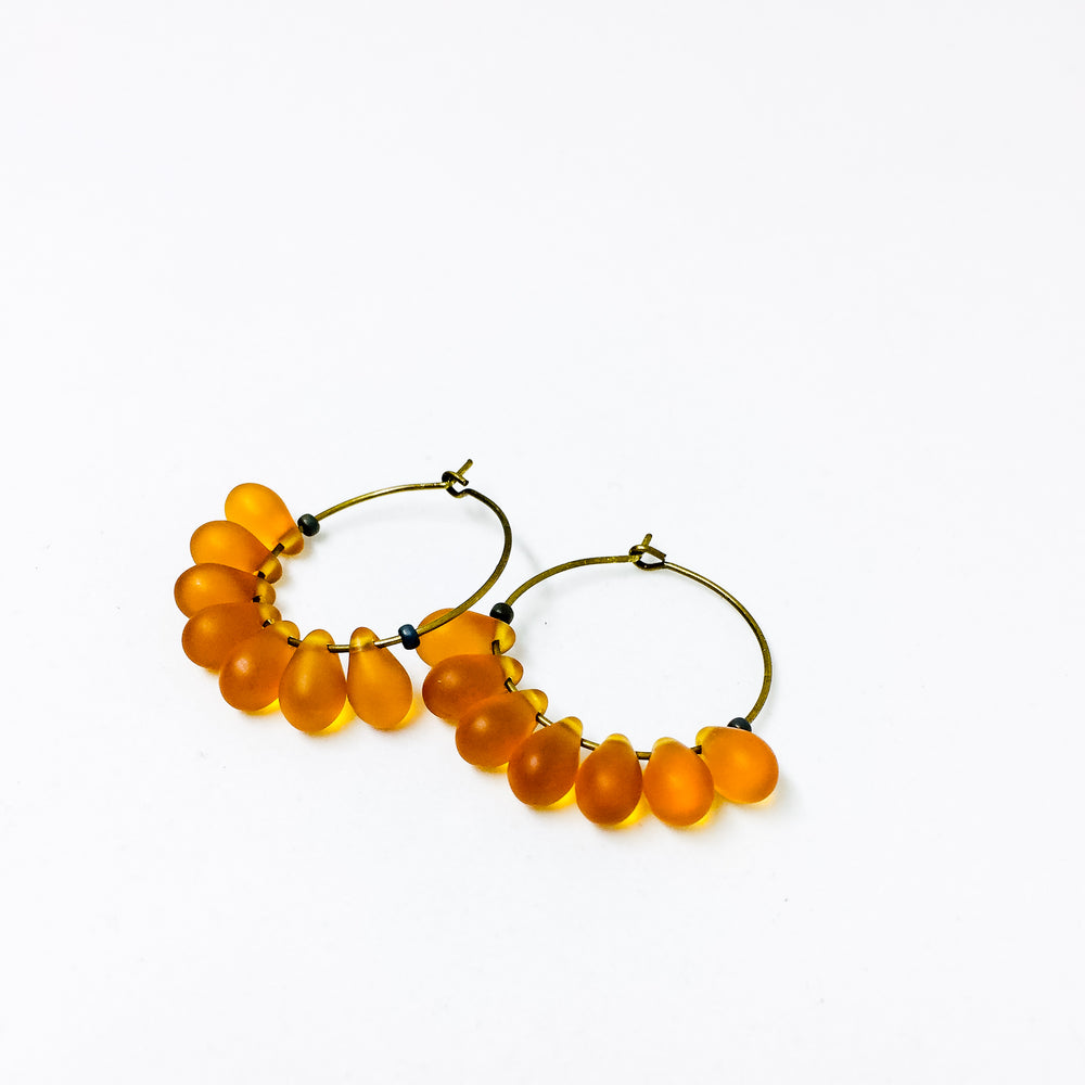 Dewdrop beaded glass hoop earrings in amber