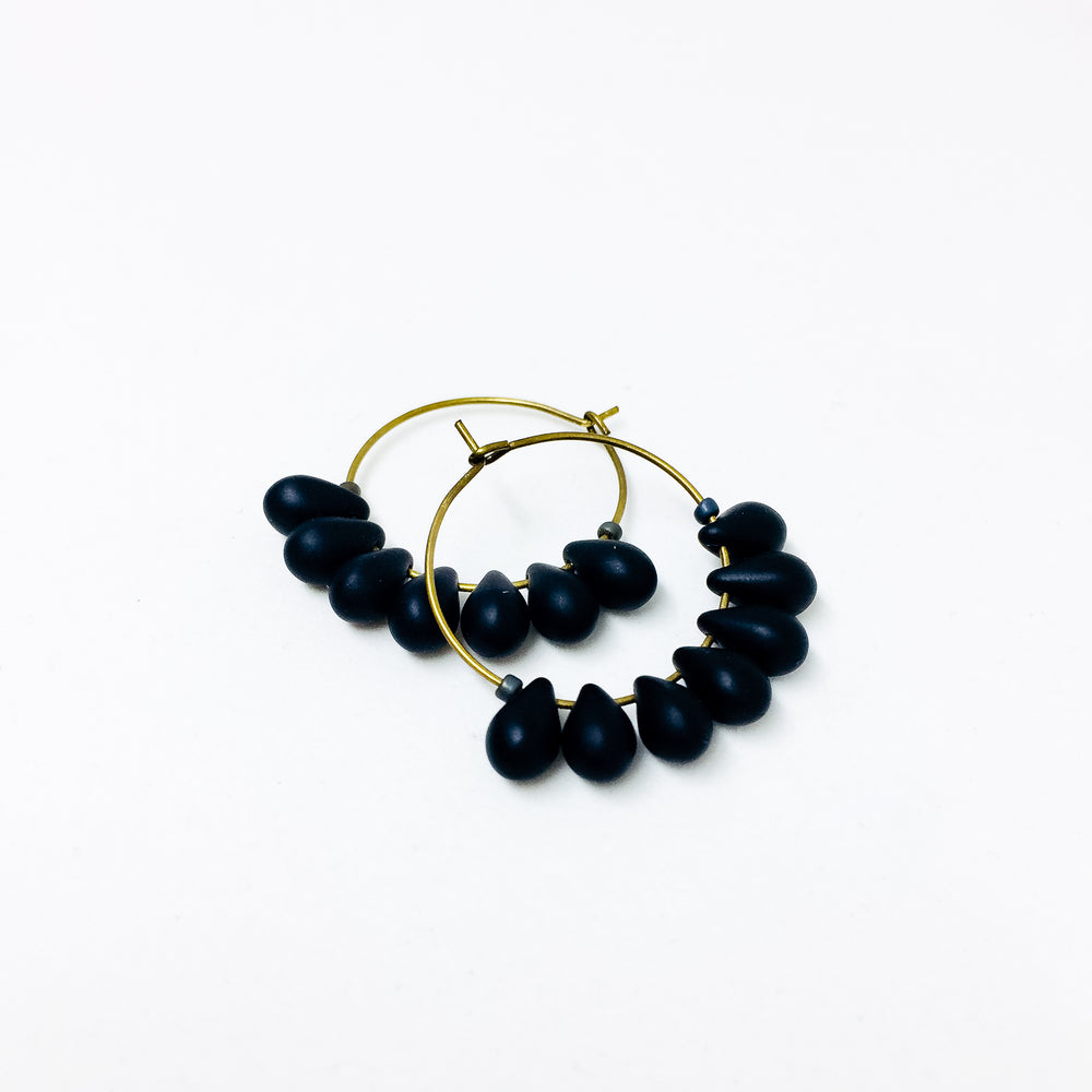 Dewdrop beaded glass hoop earrings in jet black