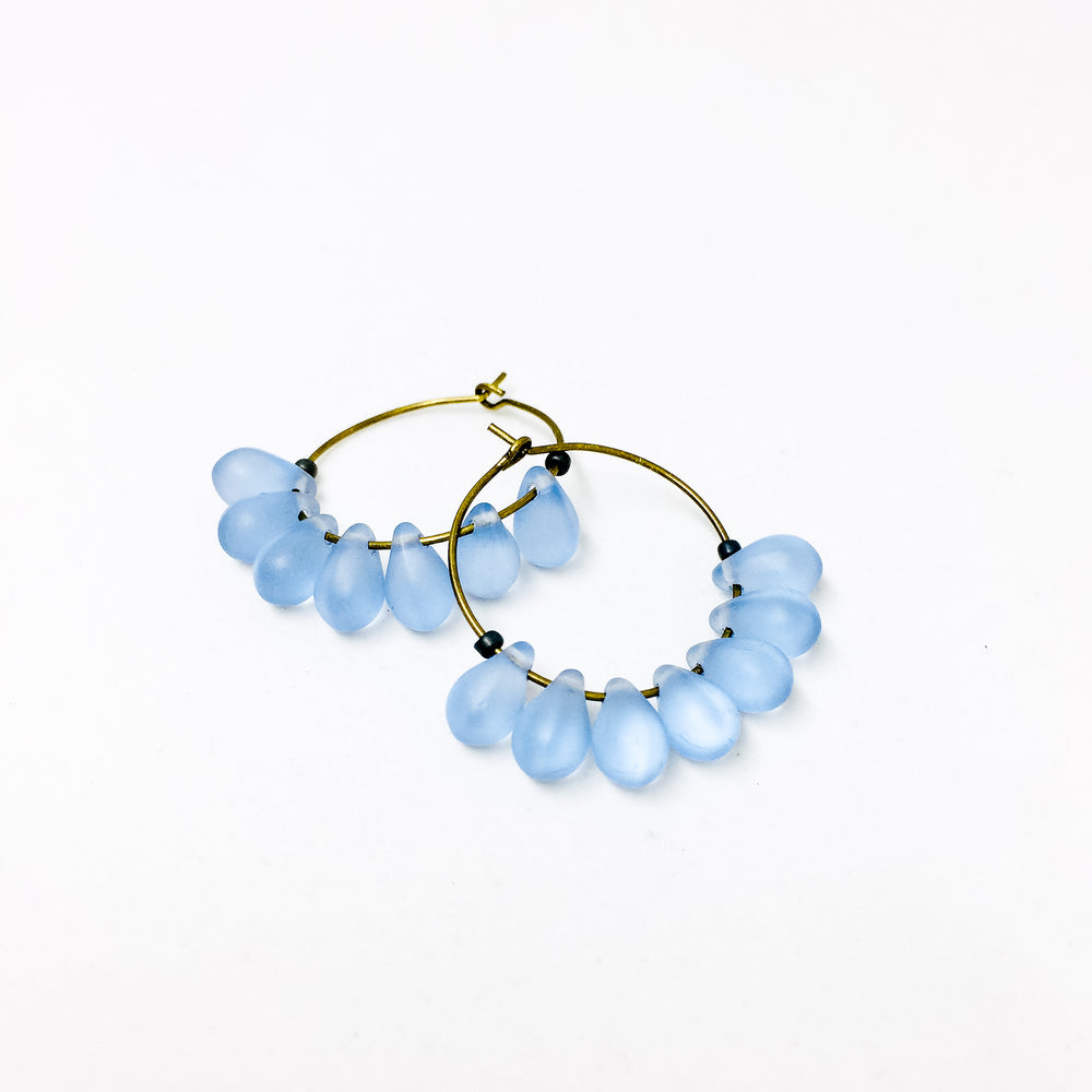 Dewdrop beaded glass hoop earrings in sky blue