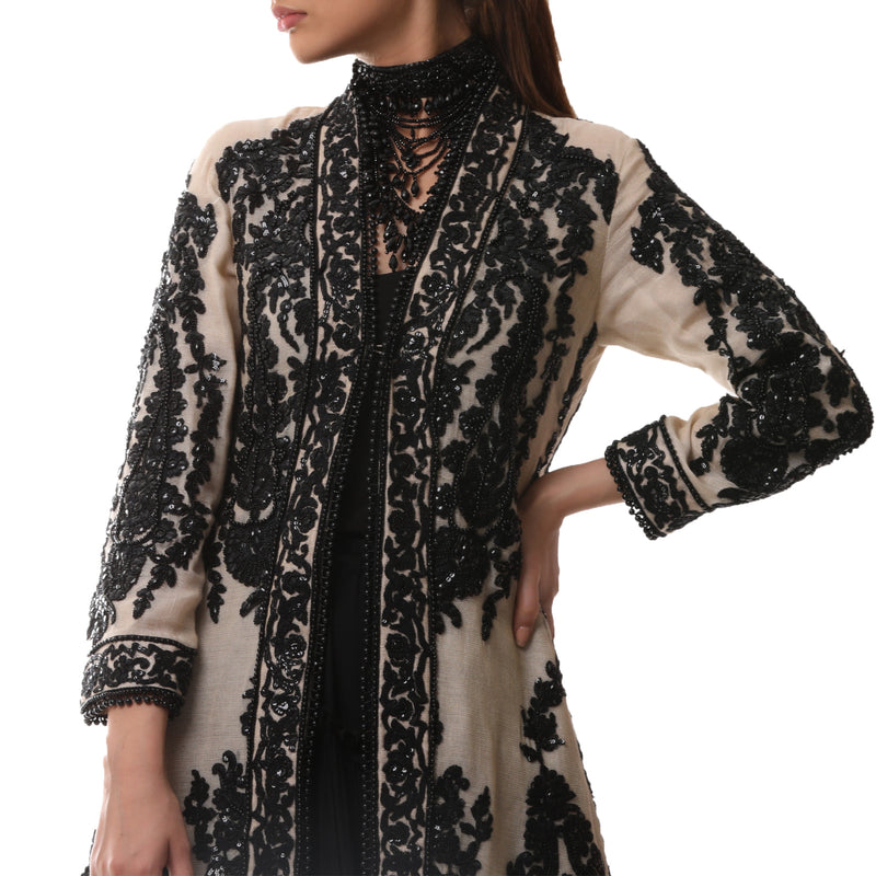 Heavily embellished long A line coat
