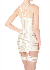 The iconic cream Bondage Angela Girdle Dress is embellished with symmetrically placed 24k gold plated oversize rings for a touch of S&M de luxe. For a fierce look pair with stockings and add accessories.