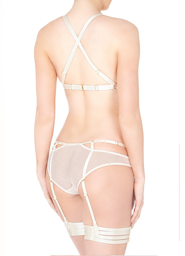 Classic yet provocative, this soft mesh cut-out brief is an essential knicker for your lingerie drawer. Side adjustable elastic straps enhance the waist, while the detachable suspenders transform the brief from an everyday style into a seductive boudoir staple or bridal treat.