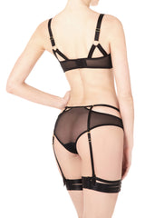 Classic yet provocative, this soft mesh cut-out brief is an essential knicker for your lingerie drawer. Side adjustable elastic straps enhance the waist, while the detachable suspenders transform the brief from an everyday style into a seductive boudoir staple.