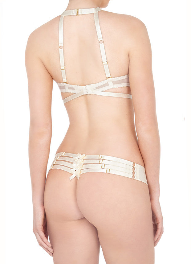 Classically elegant with a naughty twist, the ouvert Bondage Shelf Bra is a bondage inspired boudoir showpiece. Available in cream for a bold and beautiful bridal look.