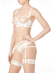 Our playful, ouvert cream harness brief with contrasting cream signature elastic panels. The open Harness brief frames your features and is as sophisticated as it is S&M.