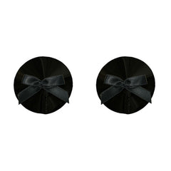 Our rich black bow nipplets are a naughty alternative to nipple covers. Designed to seduce and be seen, they are perfect finishing touch to any Bordelle boudoir ensemble.