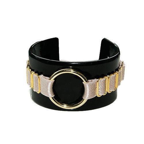 This jet black and caramel Perspex cuff accessory is the new season's statement piece of fashion hardware. Affordable luxury with a hint of S&M sensuality. Embellished and subtly engraved with Bordelle's logo for a chic finish.