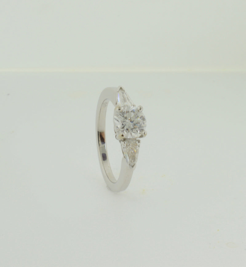 Round Brilliant Cut Diamond Engagement Ring with Bullet Cut Diamond Accents