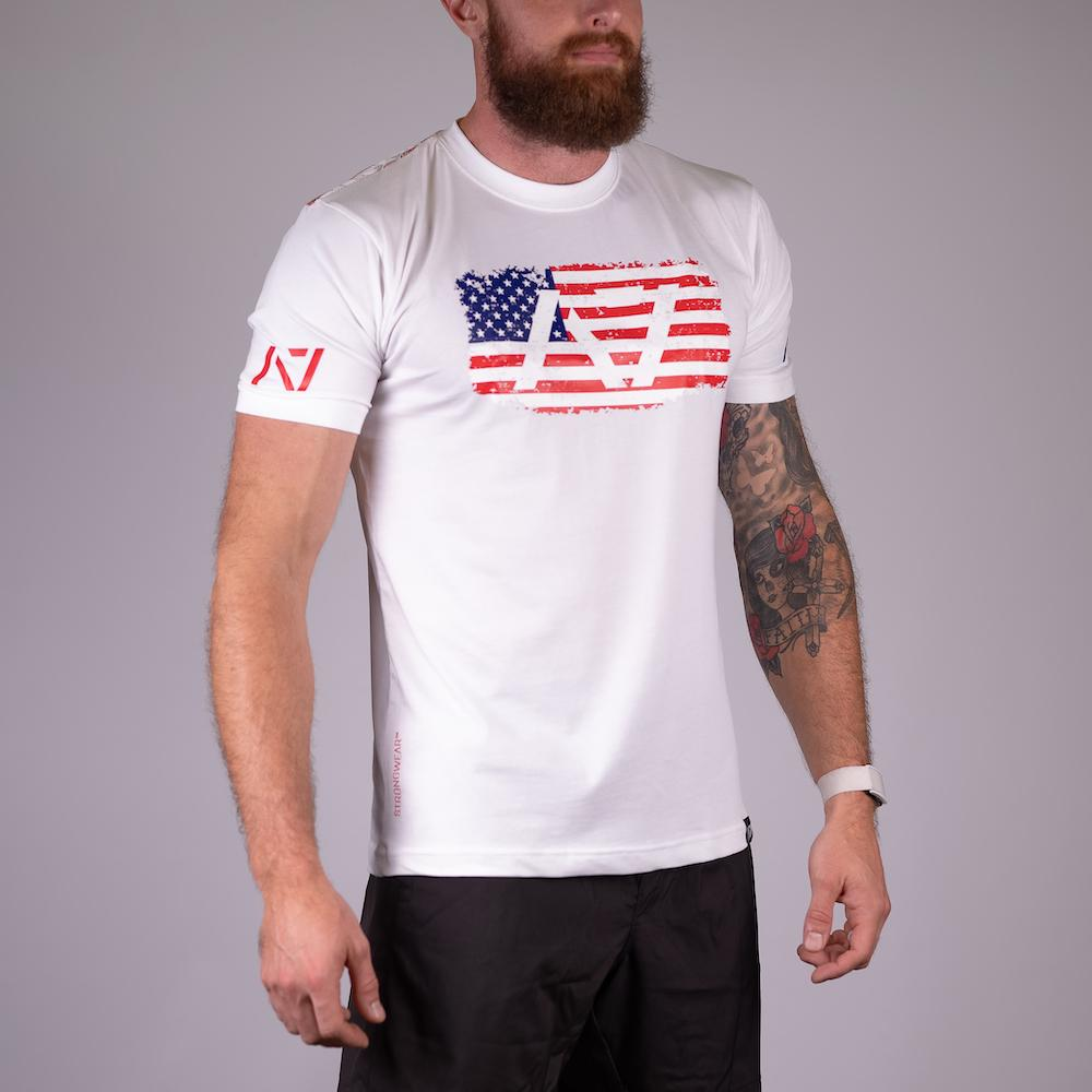 Americana White Bar Grip T-shirt, great as a squat shirt. Purchase Americana White Bar Grip tshirt from A7 UK. Purchase Americana White Bar Grip Shirt Europe from A7 UK. Best Bar Grip Tshirts, shipping to UK and Europe from A7 UK. Americana White bar grip tshirt that features American flag on the front and on the Bar Grip pattern on the back! The best Powerlifting apparel for all your workouts. Available in UK and Europe including France, Italy, Germany, Sweden and Poland.