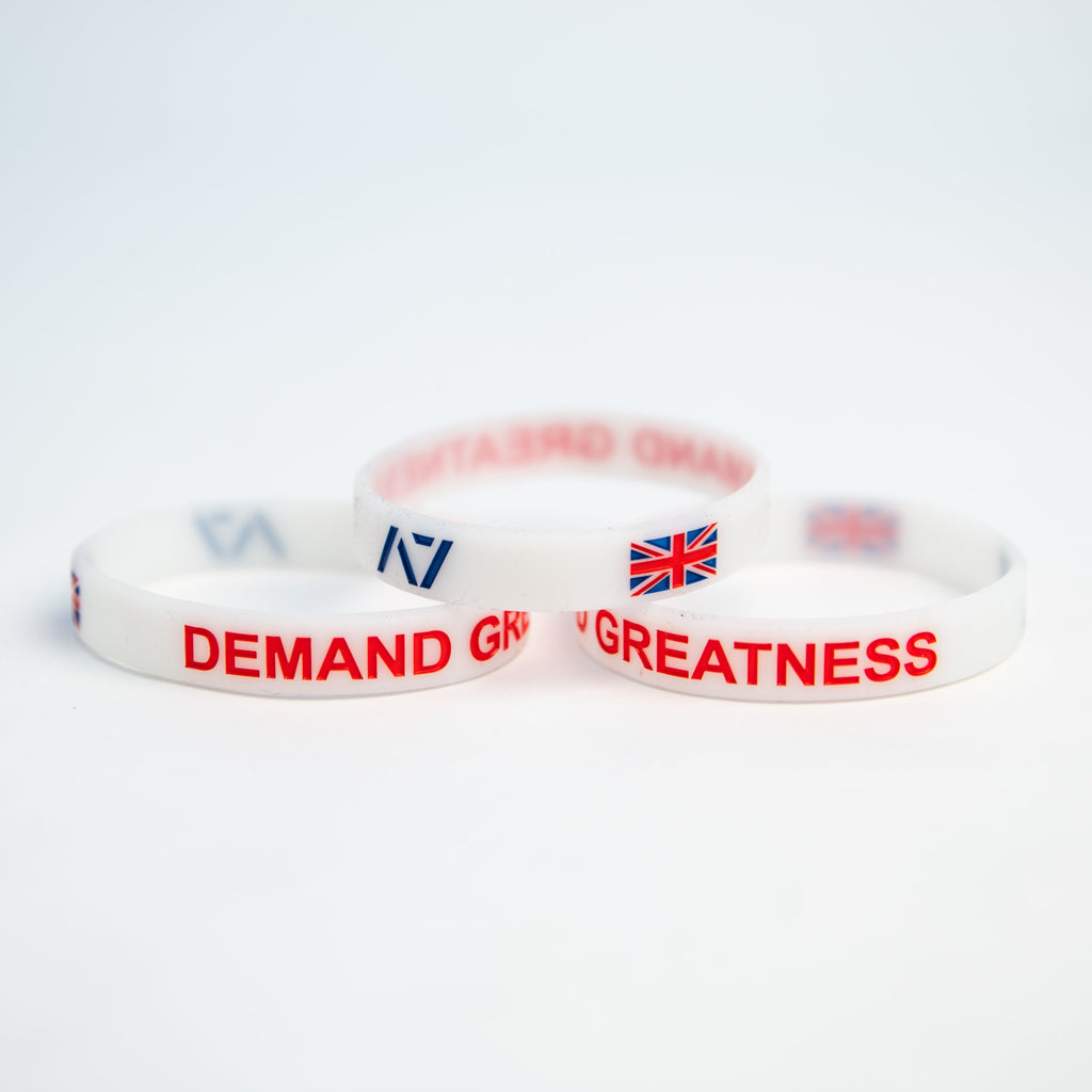 You are always working towards your goals and helping others reach their full potential. Feel the British spirit with this country wristband design that incorporates the UK flag into wristband and reminds you to always Demand Greatness. The wristband is 1/2 inch wide, glows in the dark and features black debossed lettering.