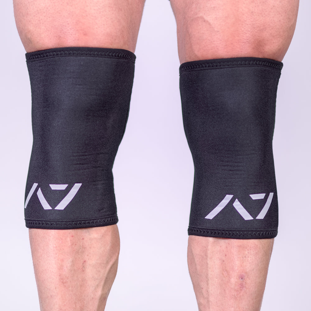 A7 IPF approved Black CONE knee sleeves are structured with a downward cut panel on the back of the quad and calf to ensure ultimate compression at the knee joint. A7 CONE knee sleeves are IPF approved for use in all powerlifting competitions. A7 cone knee sleeves are made with high quality neoprene and the knee sleeves are sold as a pair. The double seem on the knee sleeves create a greater tension on the knee joint. Available in UK and Europe including France, Italy, Germany, Sweden and Poland