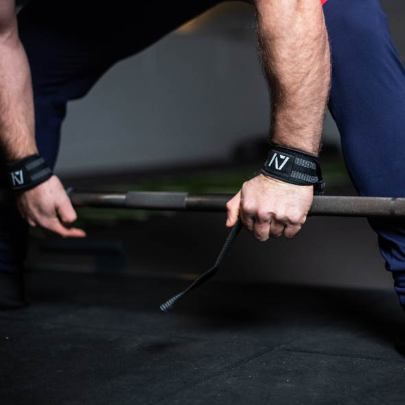 PULL wraps are wrist wraps that help with grip for deadlifts. Going for reps or going for pulls when your strength is shot. These new Pull wraps feature a neoprene padded wrist strap that can lock in above where your wrists bends. We added a grip enhanced strap that wraps around the bar to help hold the bar during deadlifts or rack pulls with more comfort and security than leather or nylon traditional straps.