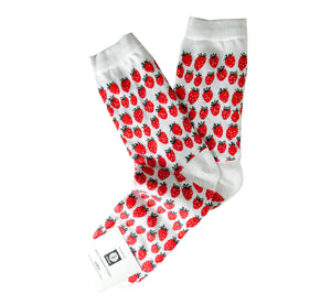 Pair of white socks with many red strawberries, cuff and heel white, breathable, resistant, ethically made in Scandinavia.