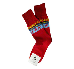 Pair of red merino wool socks, Lapland reindeer pattern, superwarm, resistant, ethically made in Scandinavia.