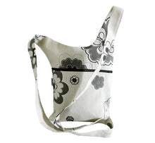 Load image into Gallery viewer, asymmetric shoulder bag, off white with gray flowers, 22x32 cm, long strap made of bag fabric, black zipper in side pocket, handmade in Scandinavia.
