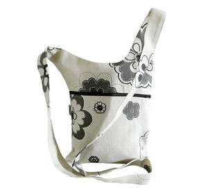 asymmetric shoulder bag, off white with gray flowers, 22x32 cm, long strap made of bag fabric, black zipper in side pocket, handmade in Scandinavia.