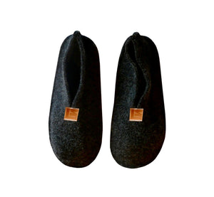 Warm, comfortable and cozy black slippers, home shoes handmade of felted wool, Nordic reindeer leather sole.