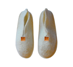 Warm, comfortable and cozy white slippers, home shoes handmade of felted wool, Nordic reindeer leather sole.