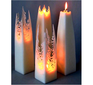 Four white tapered square pillar candles, form a lace-like shape as they melt and creates a magical atmosphere, handmade.