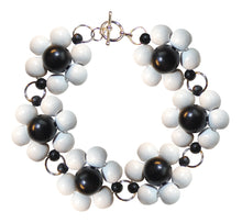 "Load image into Gallery viewer, Wood flower bracelet handmade, white and black wooden beads, silver nickel free hooks, 19.5 cm, 7,68"", flower diameter 2.4 cm, 0.95""."