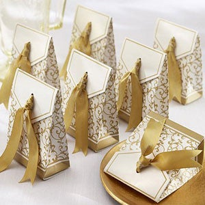 Wedding favour box with gold ribbon