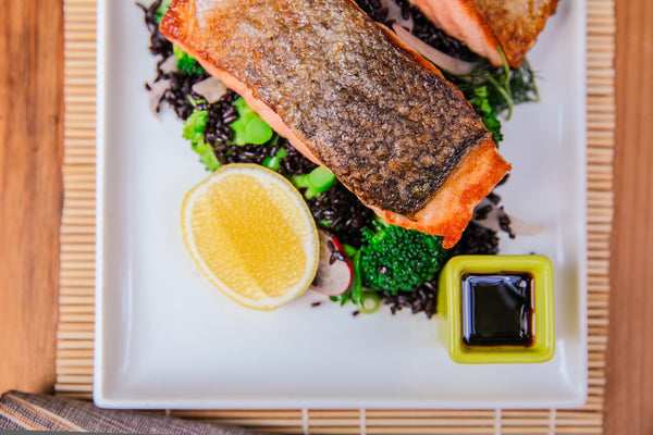 Seared Salmon Feast Layed Over Black Rice