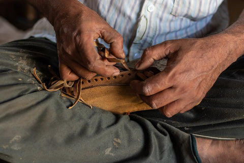 man's hands with barehands leather shoes