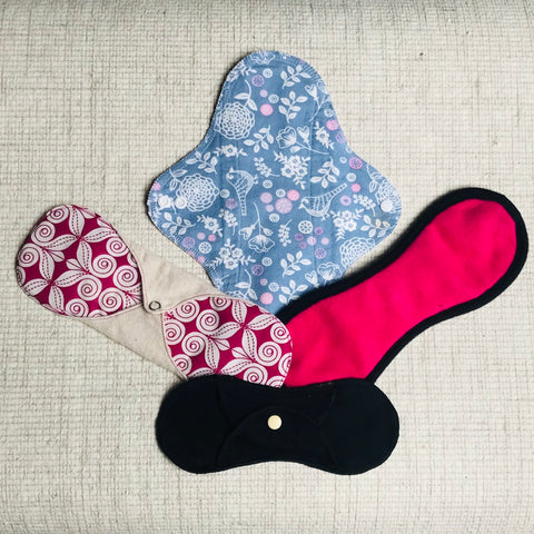 reusable sanitary pads including imse vimse, bloom and nora, eco femme and fialuna