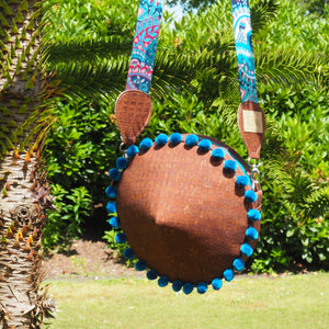 Brown canteen round cork bag with turquoise pompoms