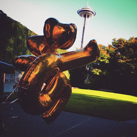 gold balloons and space needle
